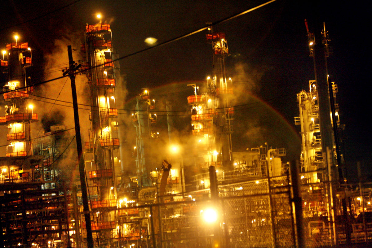 An oil refinery in Texas lights up the night sky.