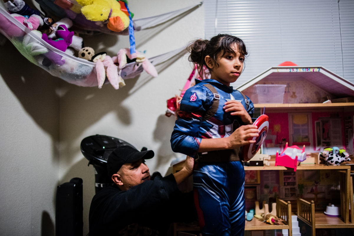Vinson suits up Lily as Captain America while playing at home.