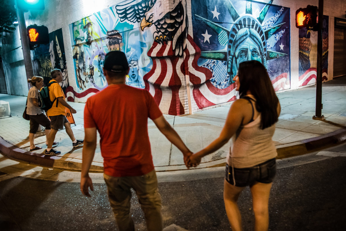 Vinson and Brittney pass an America-themed mural in Downtown Fresno.