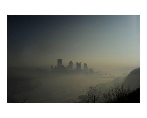 Pittsburgh's skyline rises above the fog November 9, 2010.